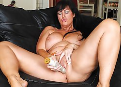 Horny British MILF gets her pussy soaking wet