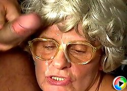 Granny in glasses gets a facial