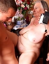 Two young studs have lured a nasty granny into sucking cock