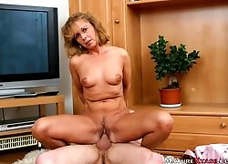 She licks soft dick head and gulps erected cock very deep.