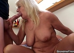 The eager grandma is taking two dicks into her pussy and mouth and the guys love it