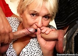 Old blonde cleaning lady is sucking and fucking with the two guys that live there