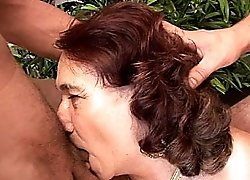 Redhead grandmother gets all her holes fucked hard