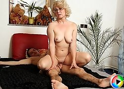 Granny munches a big cock and it gets rock hard in her tasty mouth so come and watch