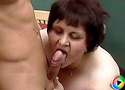Huge grandma licking and riding cock on a floor